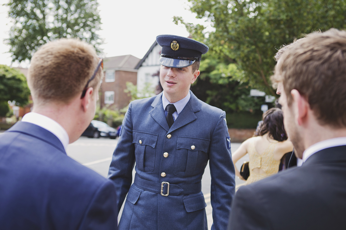 A man dressed in RAF uniform at a wedding