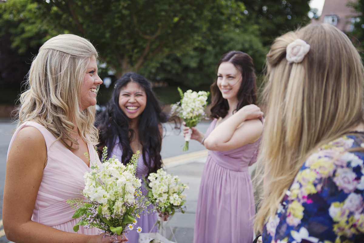 Bridesmaids laughing at a wedding