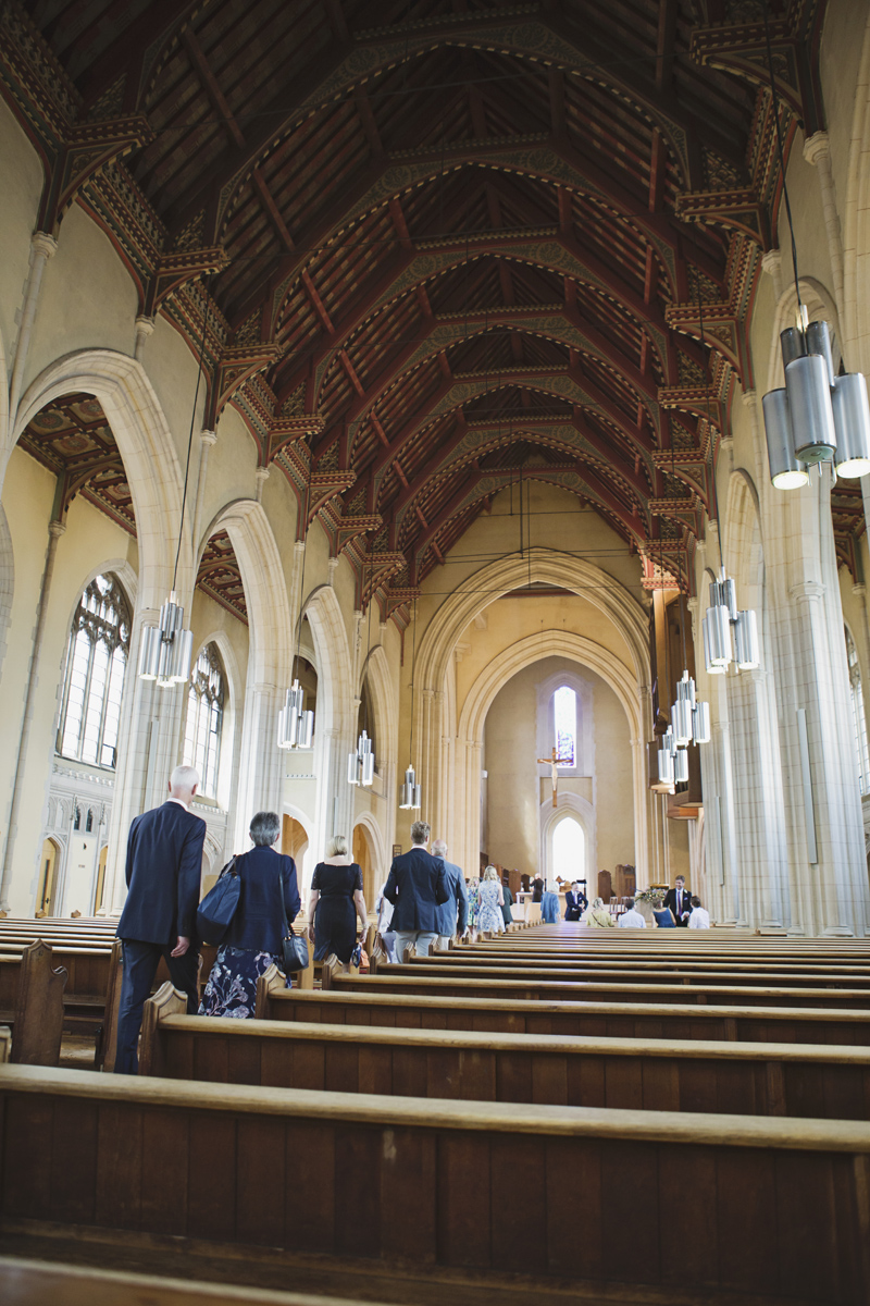 Guests walking along the aisle inside a large church