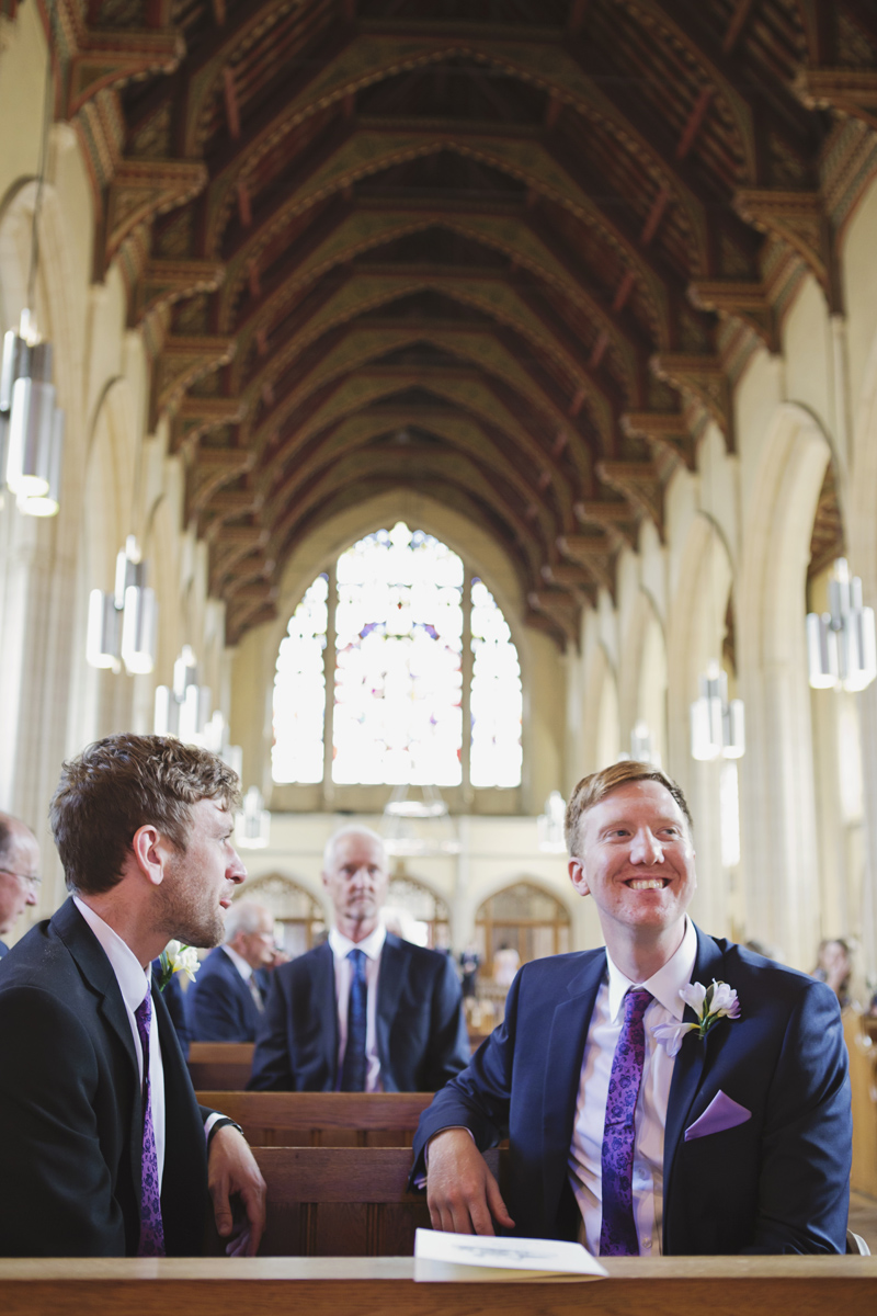 A Groom and Best Man sat waiting in a church