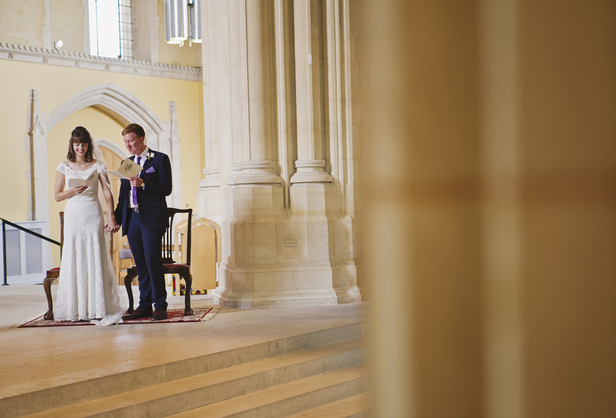 A shot of a wedding couple singing in church