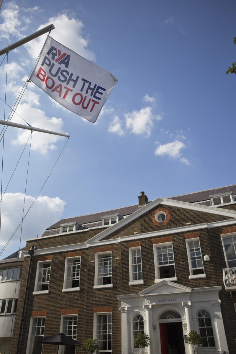 A shot of Linden House in London with a flag in foreground saying 'Push the Boat Out'