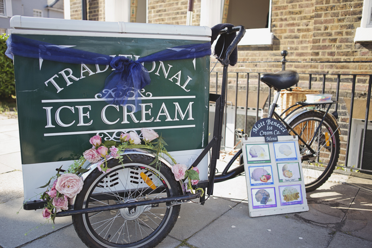 A shot of a traditional bicycle Ice Cream cart at a wedding reception