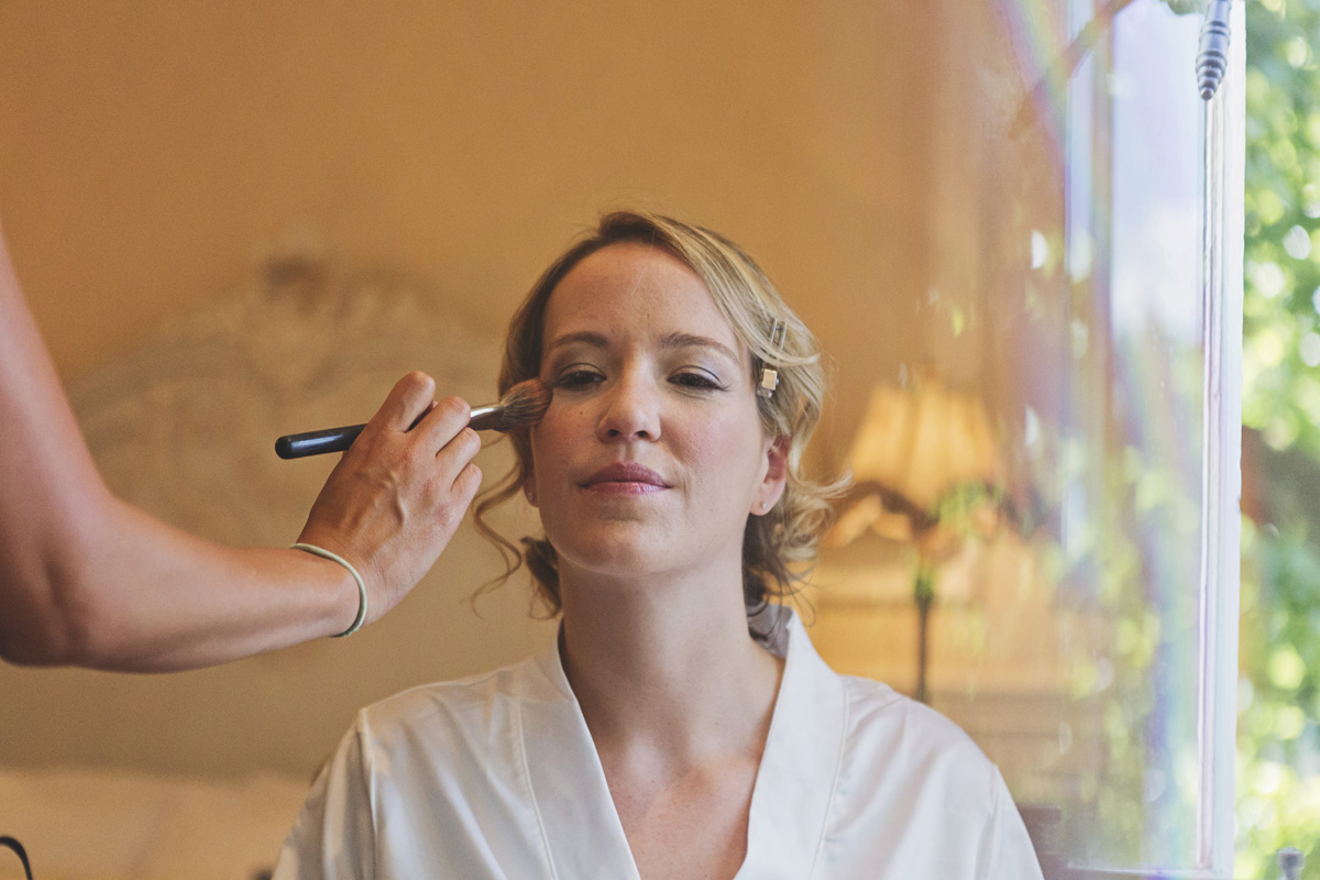 A bride to be having blusher applied to her cheek
