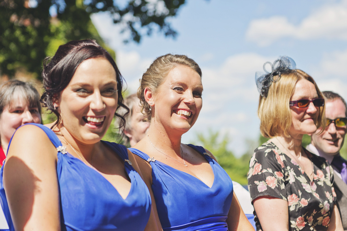 Bridesmaids smiling at the camera on a wedding day
