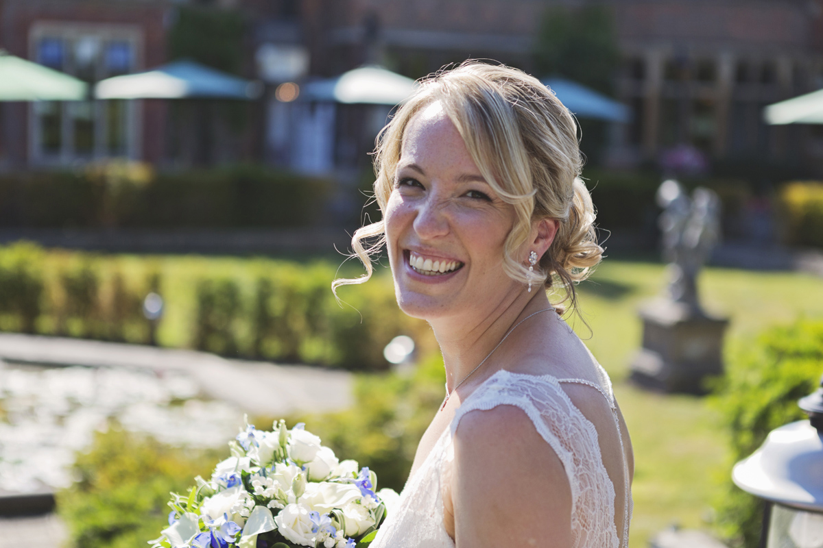 A headshot of a bride smiling at the camera