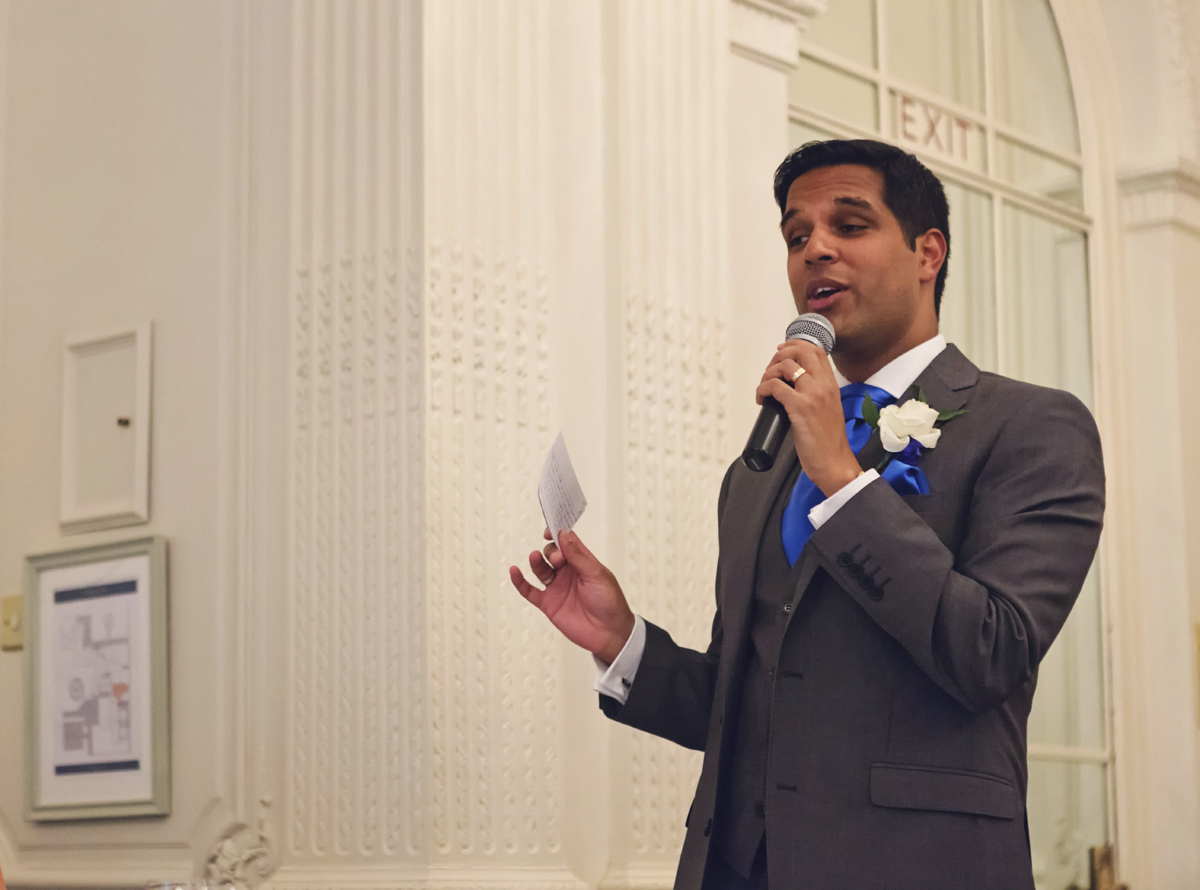 A groomsman giving a speech at a wedding reception