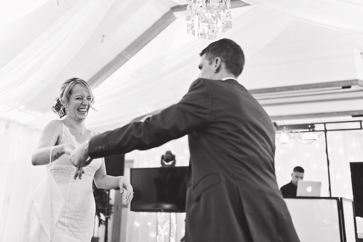 A black & white image of newlyweds during their first dance at their wedding