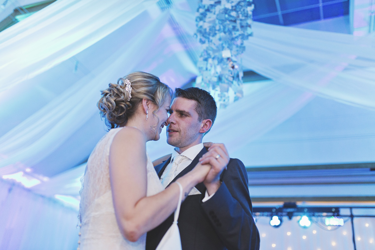 A bride & groom share their first dance at their wedding