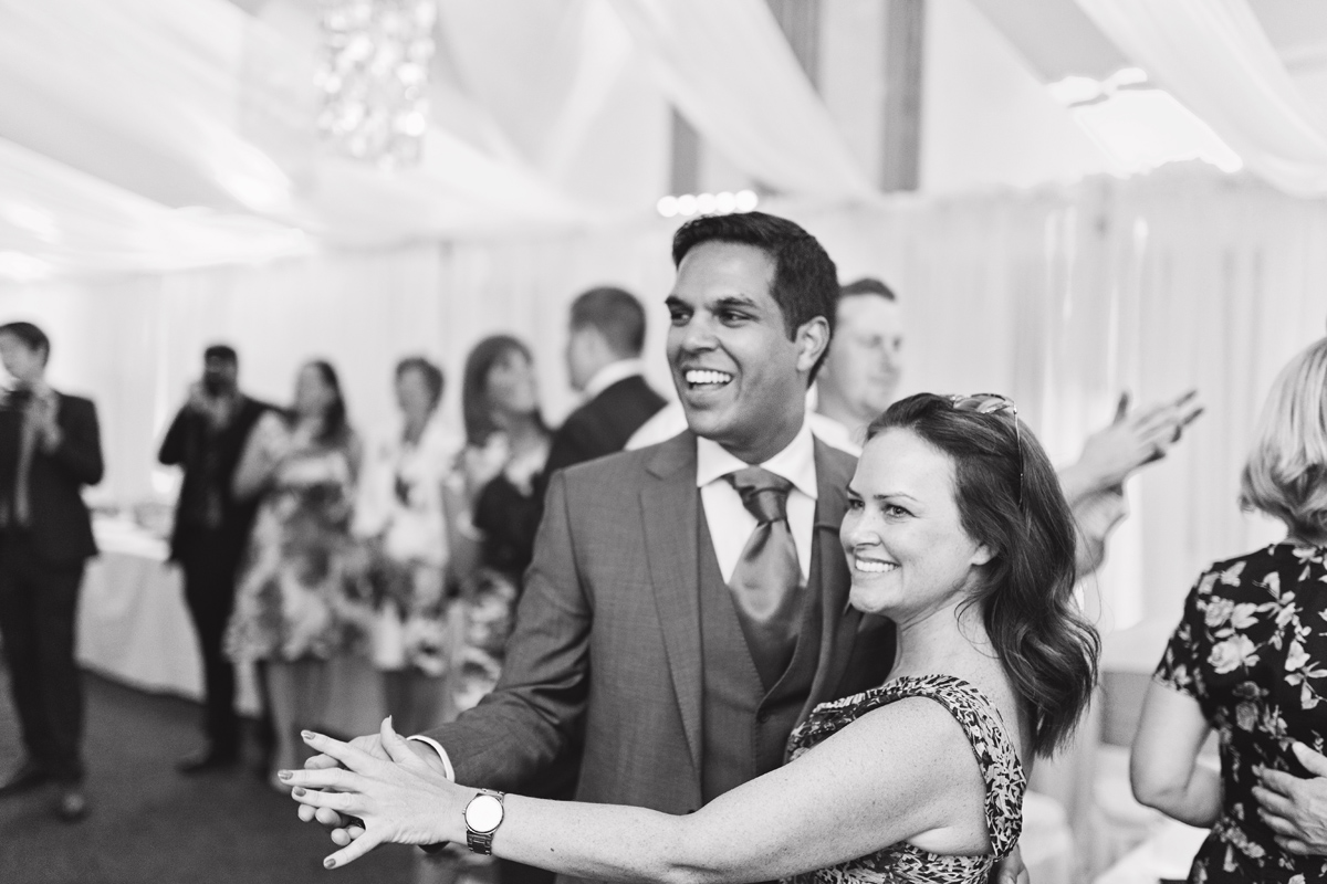 Two wedding guests dancing together at a wedding reception