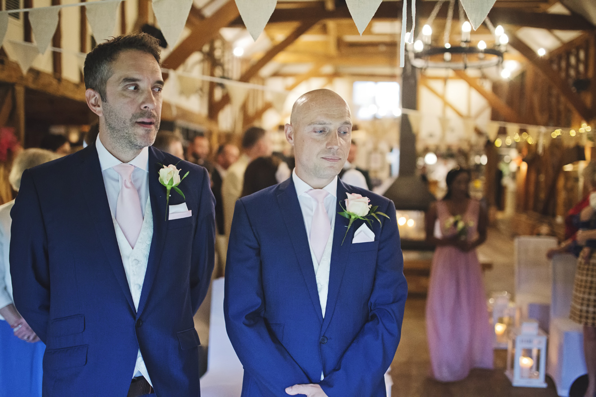 A Groom & Best Man wait at the alter for his bride