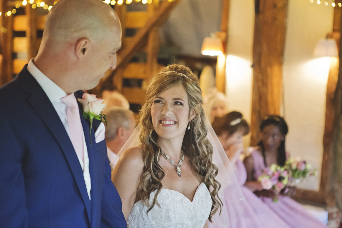 A Bride smiles at her Groom during their wedding ceremony