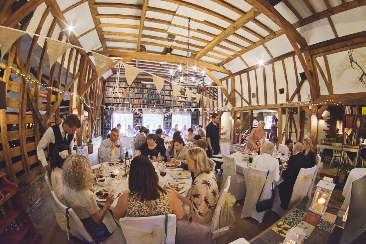 A wide shot of a wedding reception at The Red Barn in Surrey