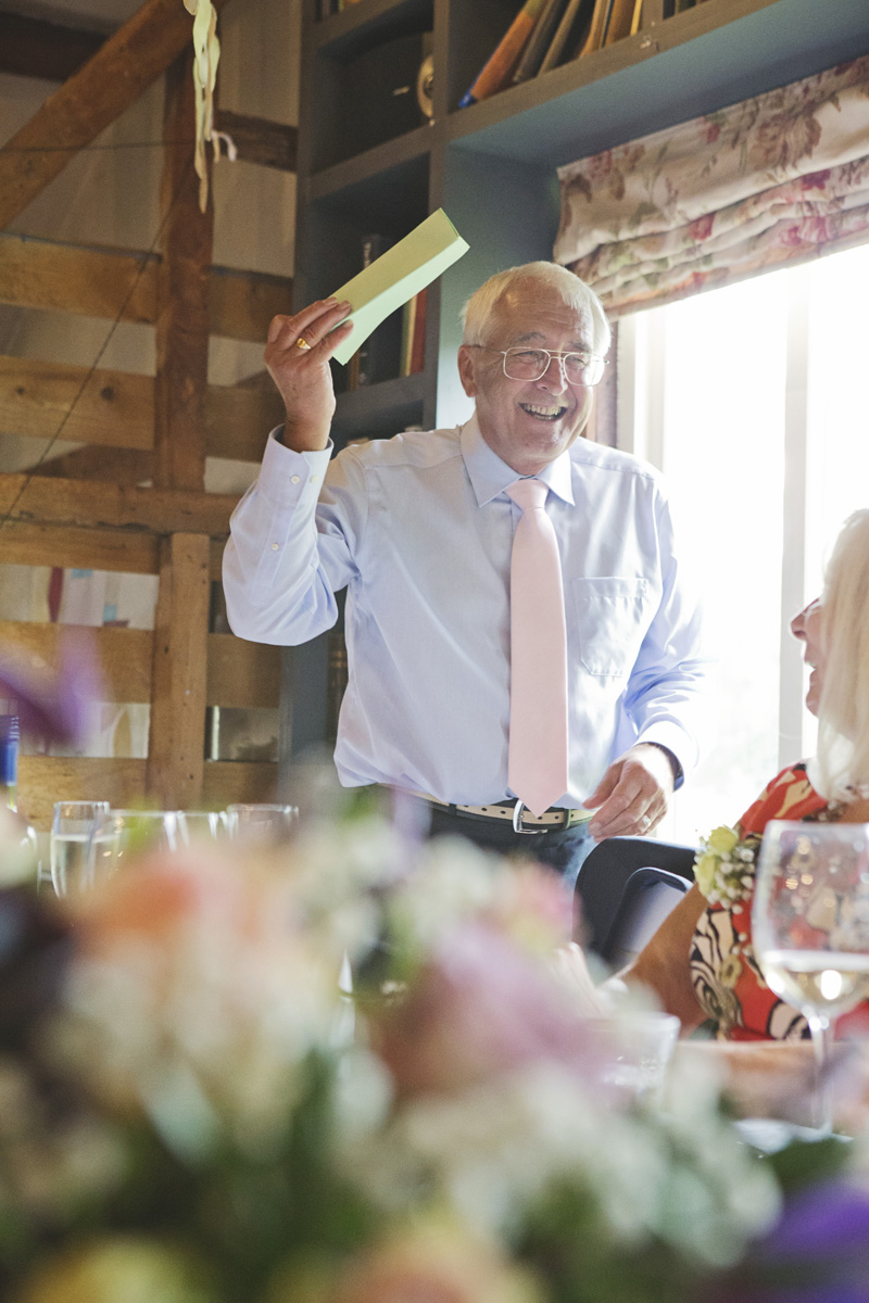 The father of the bride makes a speech at a wedding