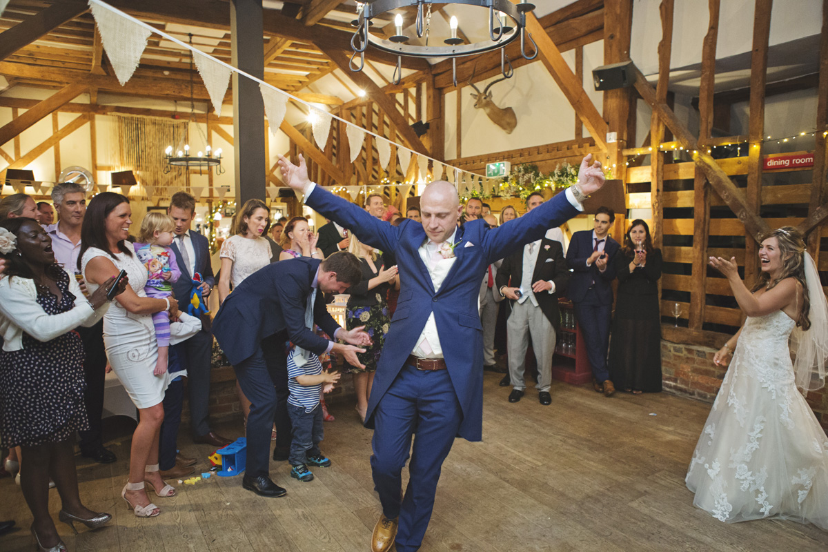 The Groom strikes a pose during his first dance at a wedding