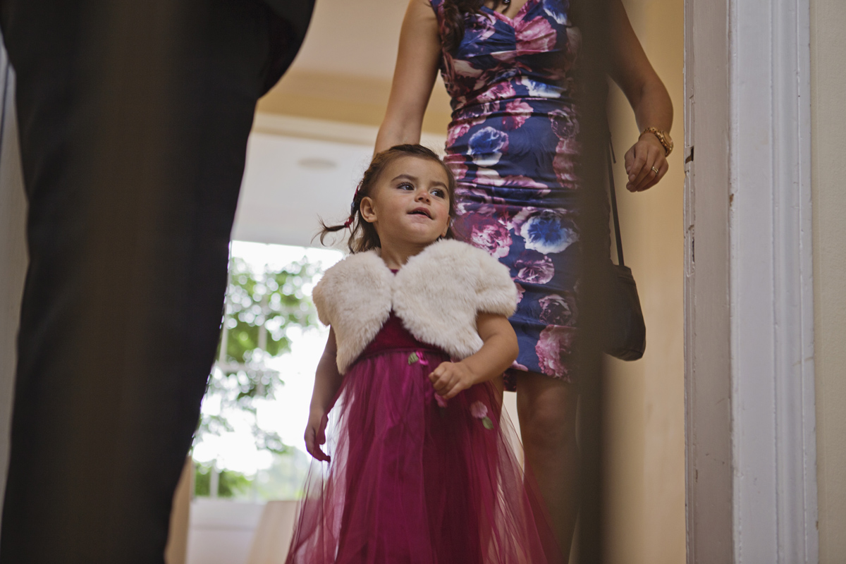 A young girl in a pink dress at a Wedding