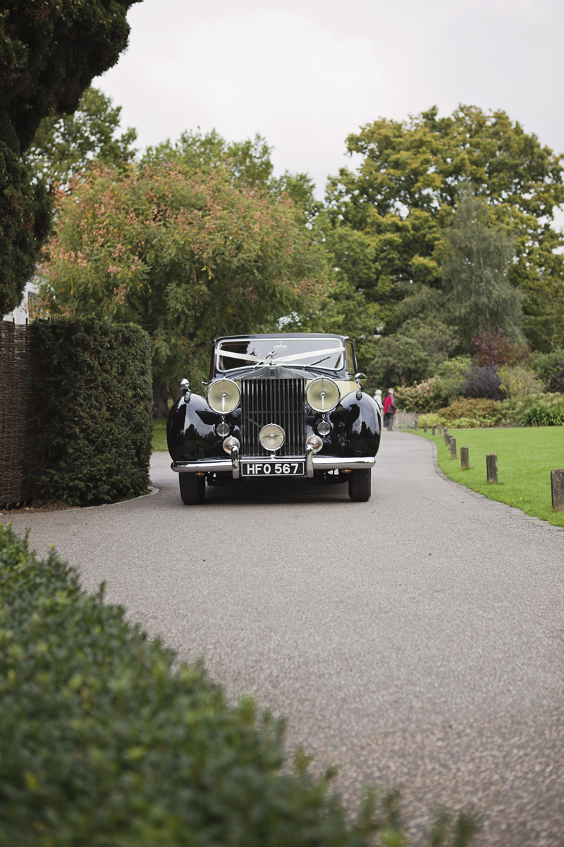 A vintage wedding car arrives at Pembroke Lodge in Richmond Park