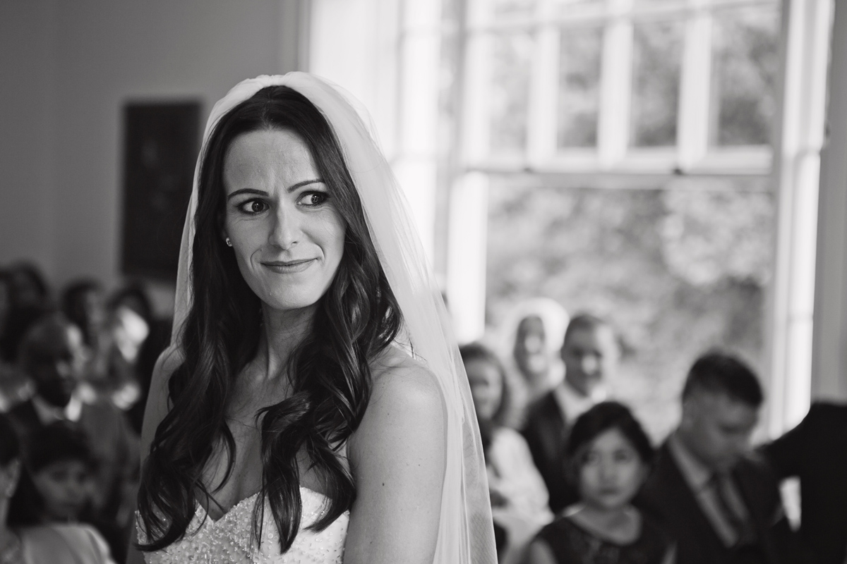A bride smiles during her wedding ceremony at Pembroke Lodge