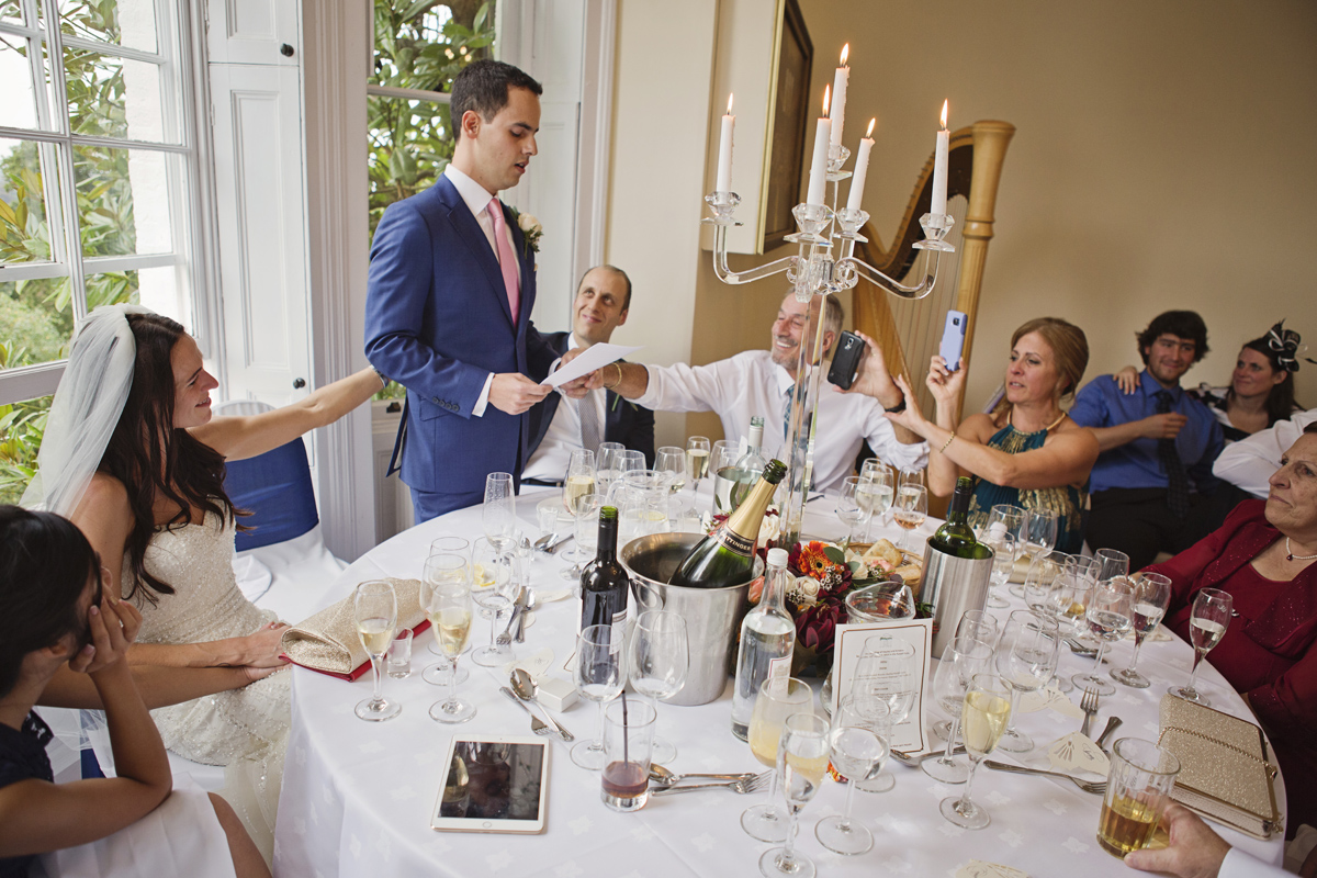 A Groom's family reach out in support as he gets emotional during his wedding speech