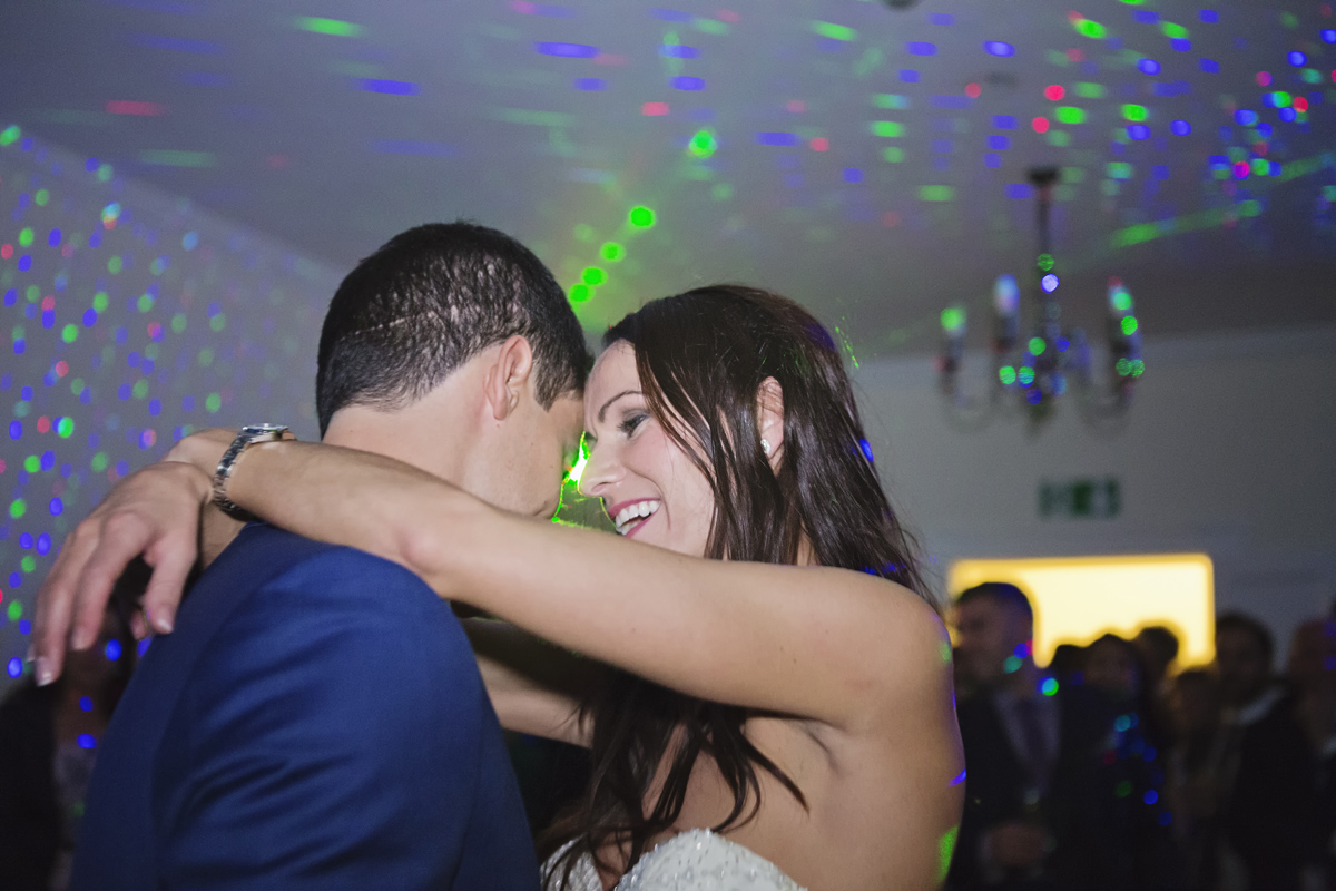 A close up shot of a bride smiling at her groom during their first dance