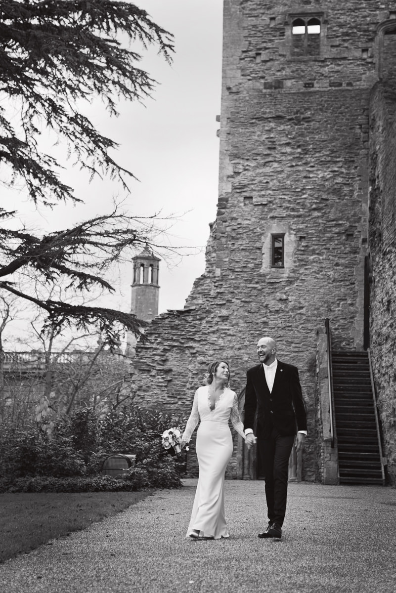 A bride & groom take a stroll in the grounds of Newark Castle
