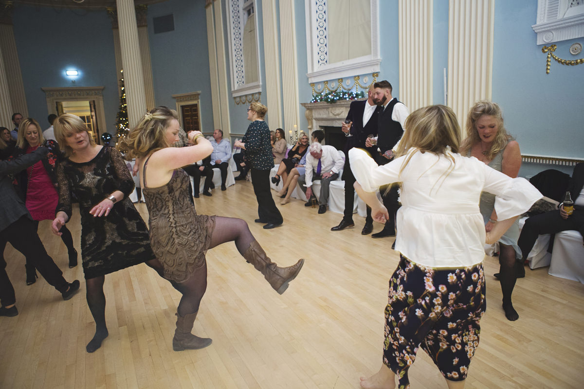 Wedding guests show off their dance moves at a wedding reception