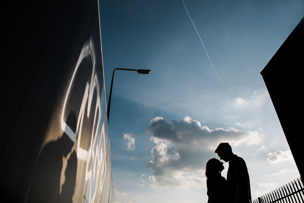 A silhouette of a young couple embracing in Liverpool