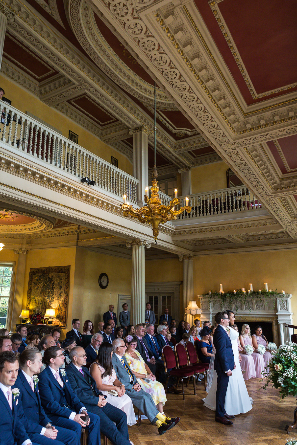 A wide shot of the wedding ceremony at Hampton Court House