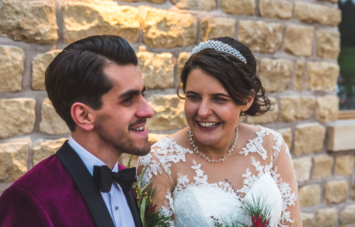 Close up of a newlywed couple laughing together
