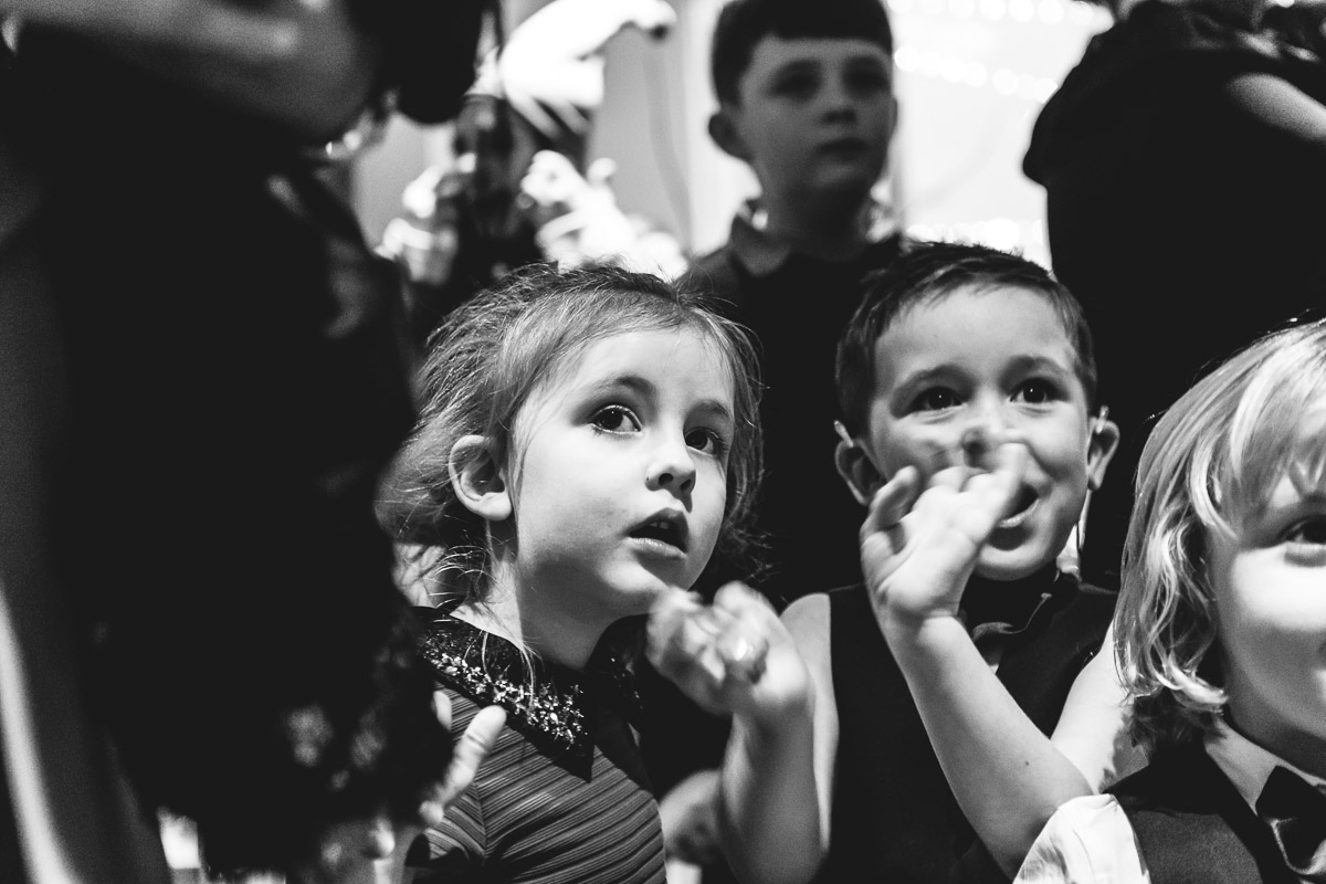 A black & white image of children looking in wonder at Santa