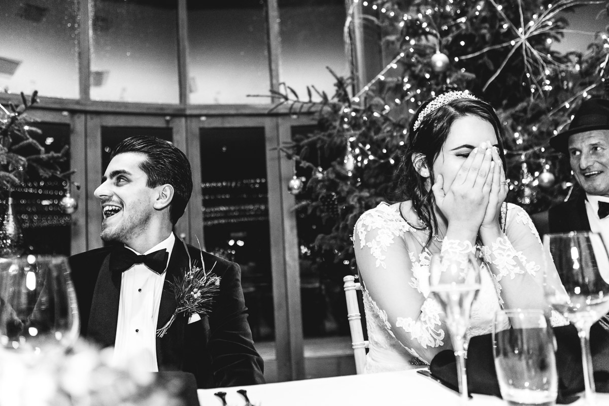 A mono shot of an embarrassed bride & groom during the speeches