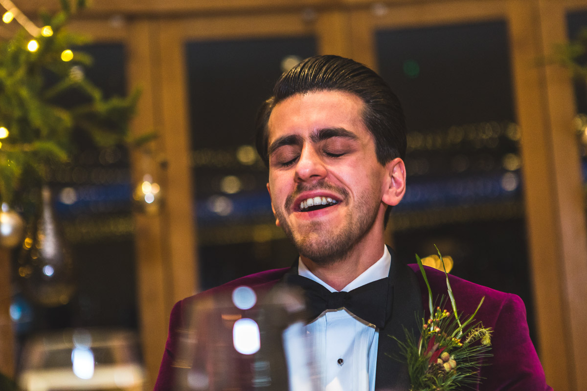 A groom looks embarrassed during his Best Man's speech