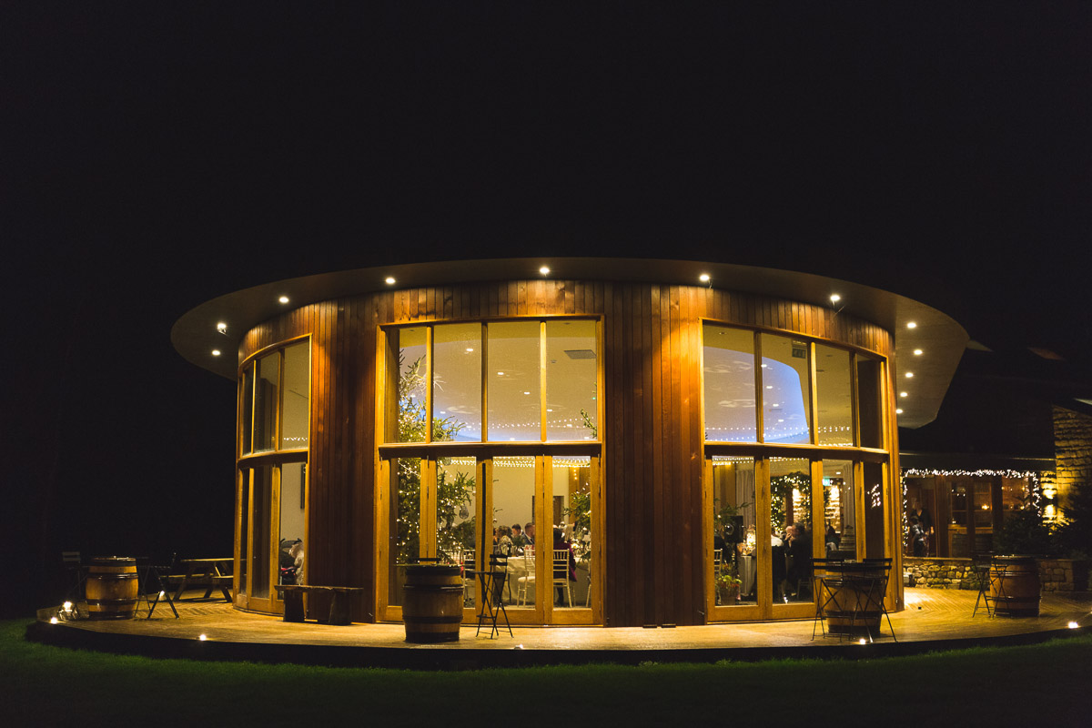 The Out Barn wedding venue in Clitheroe lit up at night